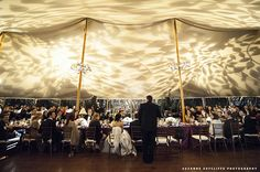 Ceiling wash/ceiling break up pattern for a wedding in a tent. Photo by Suzanne Sutcliff Photography. Wedding lighting by Synergetic Sound and Lighting.