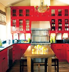I like the red cabinets. It makes this kitchen pop.