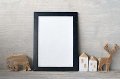 mockup of blank frame poster on wall by ptystockphoto on @creativemarket