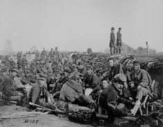 Soldiers in the trenches before battle, Petersburg, Va., 1865.