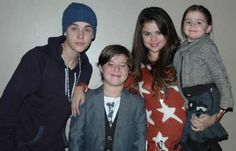 Selena Gomez  see in the Seeing Stars Lennon Sweater http://www.hintboutique.com/servlet/Categories?keyword=seeing+stars