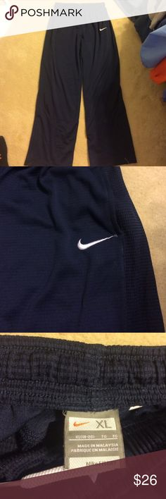 Light weight Nike sweat pants These pants are a kids XL but they fit like a women's medium or small. Super comfy and very breathable. Great workout pants. Nike Pants Track Pants & Joggers