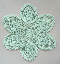 FREE PATTERN ~ C ~ @ http://www.ravelry.com/patterns/library/pineapple-doily-7768-a ~ This pattern is from the 1946 FREE PATTERNS ~ @ http://www.crochetmastery.com/dldctr/Runners2.pdf ~ Coats and Clark's crochet book Pineapple Designs. It's the bread-and-butter doily from the pineapple place settings. ~ Crochet Doily with Pineapple Motifs in by Acadian Crochet
