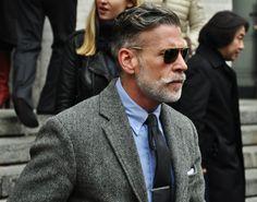 Herringbone blazer + blue shirt + aviator glasses.