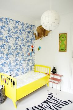 This bright yellow bed is a knockout in Oscar's Bright, Bold Abode