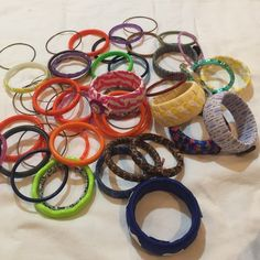 Huge bundle of over 50 costume jewelry bracelets. Great for resale or gifting. 10 are handmade, embellished with various materials, the rest are a combination of metal and plastics. All in good condition. Jewelry Bracelets