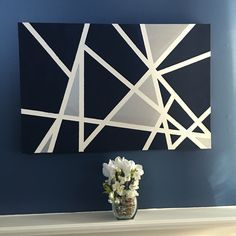DIY canvas tape painting, and a centerpiece made with discount items from Walmart. Wall color: denim blue. All designed and arranged by us.