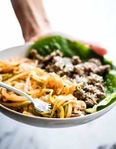 """Spiralized Apple """"kimchi"""" salad with Garlic Beef! This healthy Asian inspired spiralized apple salad makes a quick kimchi substitute. A 20 minute Paleo meal! Part of dairyfree and gluten-freeanti-inflammatory meal plan"""