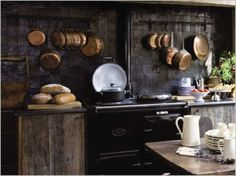 rustic dark moody kitchen with a black tile backsplash