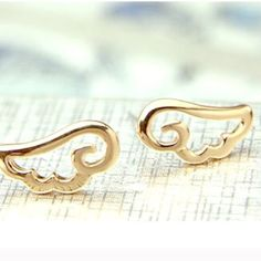 Gold plated minimal style angel wings earrings New, never worn. Stunning gold plated minimal style angel wings stud earrings. Thank you for visiting my closet, please let me know if you have any questions, I offer great discounts on bundles :) Boutique Jewelry Earrings