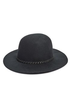 Love the faux-leather band that wraps around the crown of this trendy wide-brim hat.