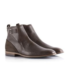 A sleek buckle boot with contrasting faux leather and suede detailing and an elegant heel with wooden elements. Smart enough to be worn under trousers or to dress-up dark denim