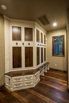 Like the contrasting wood against the simple white mudroom style storage bench