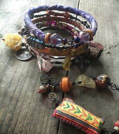 Gypsy bangle stack with yellow opal, Hmong textile, purple silk, kuchi, copper and brass bangles $60