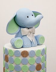 A better version of our old elephant design. I love him so much, I didn't want to part with him :( Medium: Modelling Fondant Photo Credit: Arnaldo Ilagan Photography Fondant Toppers, Fondant Cakes, Cupcake Cakes, Sweets Cake, Fancy Cakes, Cute Cakes, Baby Shower Cakes, Baby Boy Shower, Cupcakes Decorados