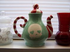 Odd teapot ... Skeleton and candy cane stripes???