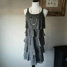 Black and white dress great condition. Worn few times. Layered look. Flowy fabric. Fully lined. Dresses Midi