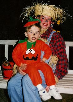 A scarecrow and her little pumpkin.