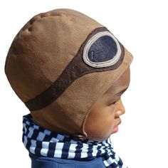 Vintage Aviator Cap handcrafted original by Soil - $36  The perfect cap for any future pilot. Velveteen exterior with a soft flannel lining. Wool felt aviator goggles are stitched all the way around. Cap straps comfortably under the chin with a vintage button closure. Great for pretend play or any day.