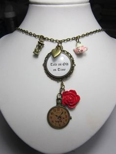 Beauty and the Beast inspired fairy tale drop necklace with antique bronze style charms.