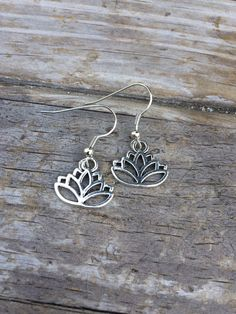 Handmade Lotus charm earrings. These simple delicate earrings are made with nickel free fishhook earrings. One of a kind piece and you will receive