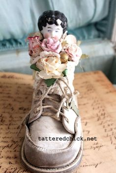 Altered Baby Shoe Frozen Charlotte by TatteredChick on Etsy, $20.00  FILLED W/PAPER FLOWERS, LACE, LITTLE DOLL HEAD