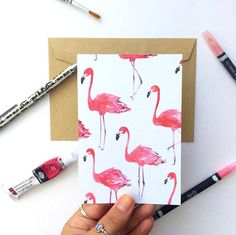 An A6 postcard print of pink flamingos  Beautiful for decoration or for sending to a friend ♥  Ive left the back of the postcard mainly blank if you want to write your own personal message, except for my name written small at the bottom.  The Flamingo print is made with quality 250gsm card  Dimensions of the flamingo postcard are: Height: 15cm Width: 10.5cm (Approx A6)  Link to the Flamingo 2 pack: https://www.etsy.com/uk/listing/522545948/set-of-two-flamingo-pri...