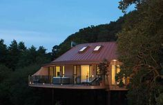 Chewton Glen; Hampshire, England -- The treehouses are part of a hotel resort in the south of England, hidden and perfectly secluded in a wooded valley for added tranquility.