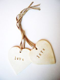 2 Personalized Wedding Ornaments Decorations Beach Our First Christmas Ornament Heart Valentines Day Gift Clay Tag Wedding Favor Home Decor by unconventionalJ on Etsy https://www.etsy.com/listing/93458934/2-personalized-wedding-ornaments