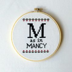 "Sterling Archer cross-stitch ""M as in Mancy"""