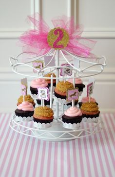 love this carousel cupcake holder, the sign and toulle