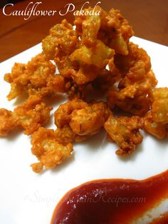 Gobi Pakora / Cauliflower Pakoda: The Indian version of cauliflower fritters. Cauliflower Pakora is our favourite snack. We make it and enjoy it as an evening snack with a cup of tea. Try the recipe @ http://simpleindianrecipes.com/Home/Cauliflower-Pakoda.aspx