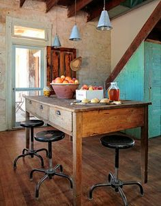 warm wood floors, big open screen doors, small bursts of color and the mix of metal with the roughness.