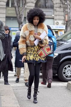Julia Sarr-Jamois in a vintage cropped fur, vintage 30s phone cord bag paired with the iconic Prada banana skirt - F* brilliant