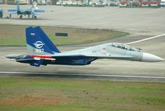 Sukhoi Su-30LL demonstrator flying along the runway at Zhangjiajie Hehua Airport…
