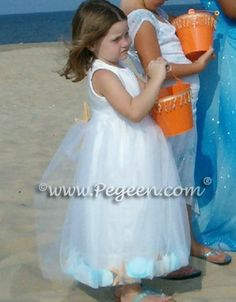 flower girl dresses for beach weddings.  Tulle is filled with not only flower petals but shells from the beaches of Florida and star fish in the skirt and back of the dress.  Pegeen Classic style 333 in 200+ colors from infants through plus sizes.