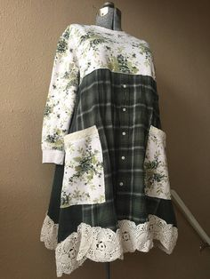 "Upcycled Rose Print Sweatshirt Dress or Tunic Patchwork Green Plaid Flannel And Jersey Knit 2 Big Pockets Ties in back Oversized loose fit Vintage Shabby Chic Crochet Hemline Measured with garment laying flat 22"" across 37"" long Free hips and waist Sweatshirt is labeled a large"