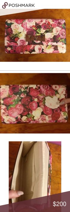 "Kate Spade Floral Rose Print Clutch Beautiful Kate Spade floral rose print clutch.  Multi colored grainy vinyl with gold tone clasp.  10""x5.5"" Roomy enough to fit your phone, makeup, and more.  Worn once for a wedding and in perfect condition except for tiny mark on INSIDE pocket.  Retails for 248.00 and sold out everywhere.  Dust bad included, 100% authentic! kate spade Bags Clutches & Wristlets"