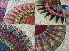 This striking quilt has been made by Ann Mulvany - the pattern is 'Ballaarat Beauties' by Michelle Yeo.  Ann has added two more rows of circles to make a large queen size quilt and slightly changed the placement of the circles in her design.. The result is a striking quilt that has so much beautiful and precise piecing. Quilting by Katrina's Quilting.