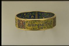 "Bracelet Devise : ""Tout par amour, partout Amour, Amour partout"" by Falize Fréres, Paris, 1901. Beautiful enameling; wish they took a better shot of it."