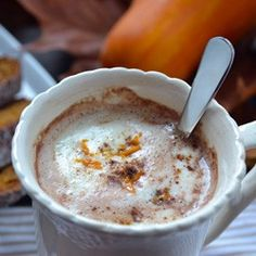 Pumpkin Hot Chocolate Coconut milk pumpkin puree honey  pumpkin patch spice Heat all up on the stove and maybe use a little 'frother' to make it just like the cafe!