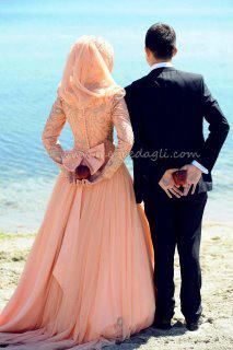 I know you're on the fence but my vote is for a pink or blush gown & hijab