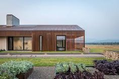 Carney Logan Burke wraps Dogtrot Residence in weathering steel to blend with Wyoming terrain Wyoming Mountains, Weathering Steel, Concrete Fireplace, Architect Design, Log Homes, Interiores Design, Modern Rustic, Minimalism, Architecture