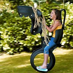 I love this recycled tyre horse swing...my mom just found one of these at a yard sale for $20 and chloe loves it