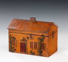 19th century tea caddy in the form of a painted country house, roof lid lifts to reveal two interior compartments