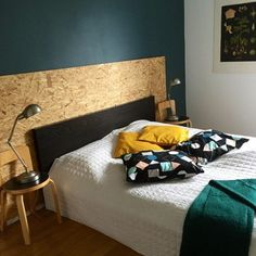 Petrol wall and osb headboard by Elina Purho