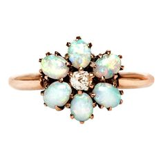 Playful Diamond & Opal Victorian Cluster Engagement Ring   From a unique collection of vintage engagement rings at http://www.1stdibs.com/jewelry/rings/engagement-rings/