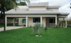 Em uma casa de 220 m² de área construída, o telhado é composto por oito �...
