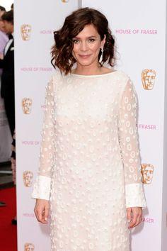 Textured, heavily curled hair on Anna Friel, showing off her asymmetrical lob #BAFTA #redcarpet #hair