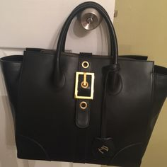 Genuine leather bag made in Italy mod Celine My Choice black work purse.  It's beautiful it has always been mistaken for a Celine bag. Good quality!  Length of bottom is 13' and top of opening is 18.5'. Height 12' width 5.5' My Choice Bags Satchels